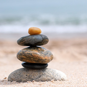 ADDS card image of stones stacked on a beach