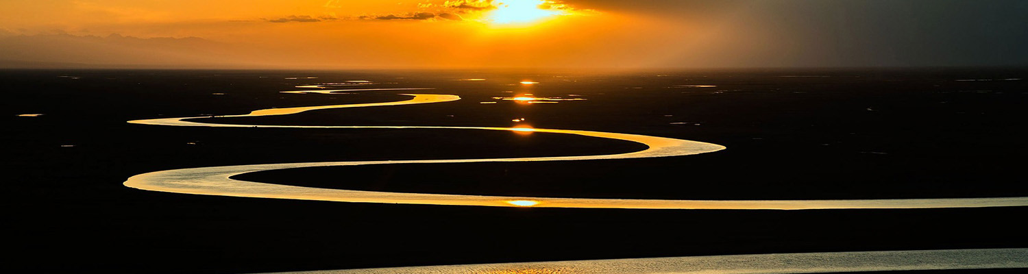 image of a river winding beneath a sunset