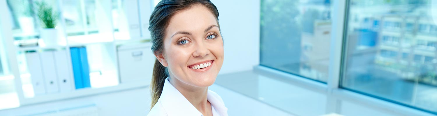 image of smiling woman in a clean bright office