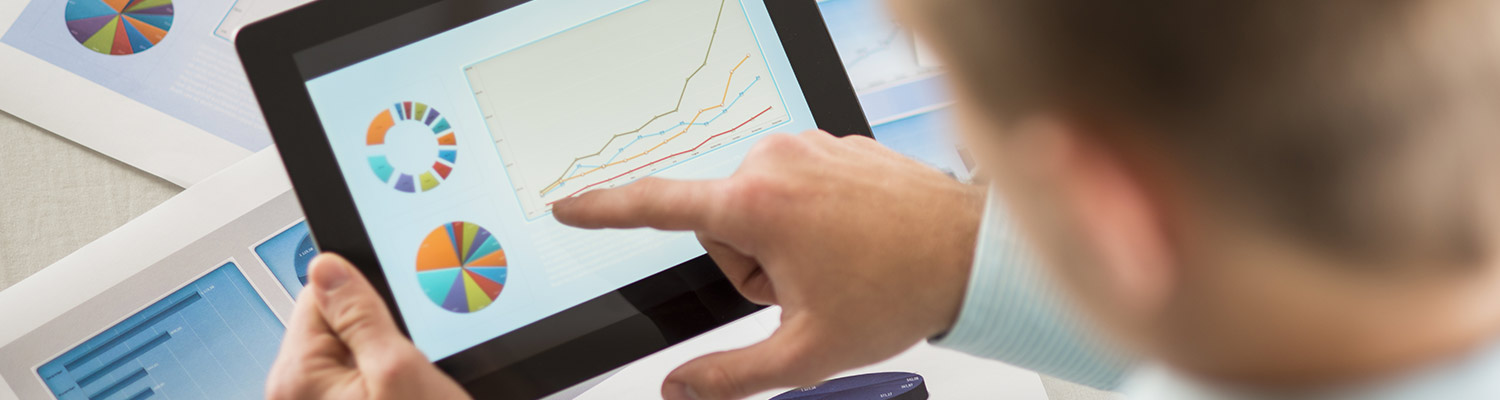 Person pointing to graph on tablet