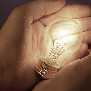 image of hands holding a lightbulb