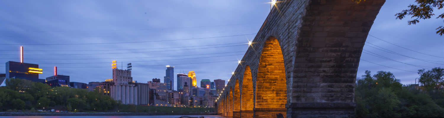 ASC Conference header - Stonearch Bridge and city skyline at dusk