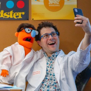 Barry Kudrowitz taking a selfie of him and a muppet with his phone