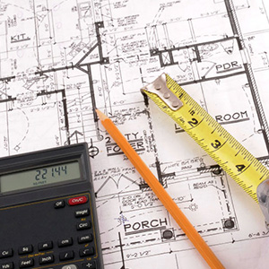 image of tape measure, pencil, calculator, and construction drawing