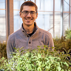 David Koser in campus greenhouse