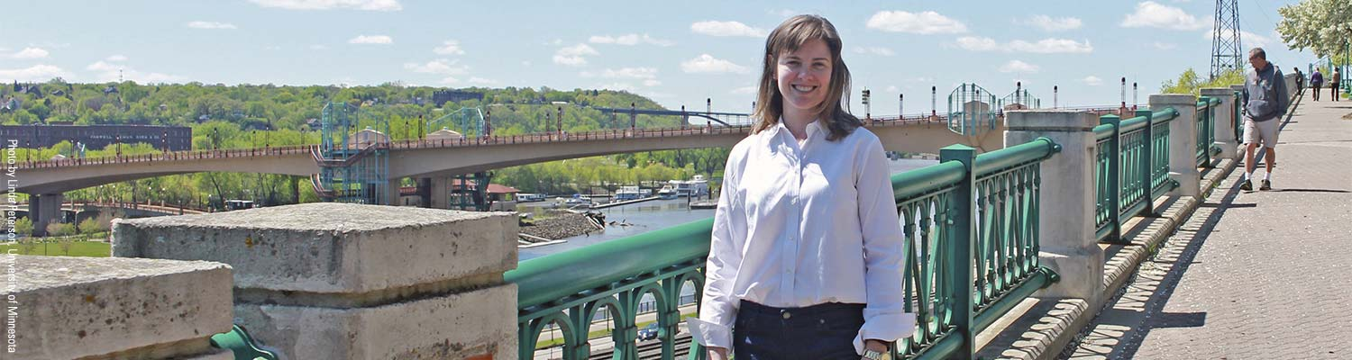 IBH alum Elizabeth Stolt on a walkway overlooking the river in St Paul