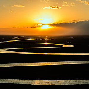 winding river beneath a sunset