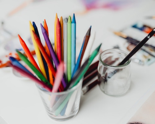 Cup of colorful pencils on desk