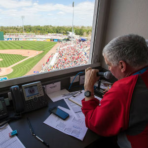 Stew Thornley in press box overlooking baseball field, Ft. Meyers