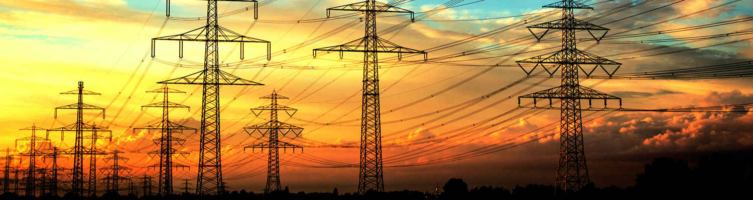 MN Power Systems Conference image - electric towers silhouetted against orange sunset