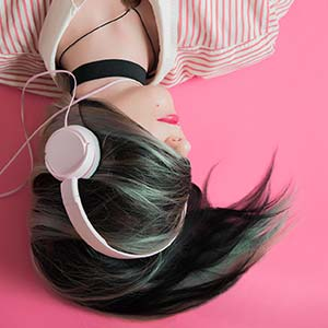 girl listening to music in headphones