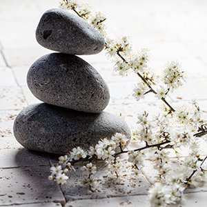 Stacked pebbles with flowers