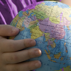 image of a child's hands holding a globe