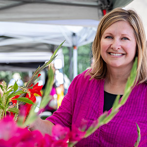 Terri Schlegel-David with gladiola flowers at farmer's market