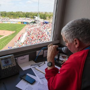 Stew Thornley observes a baseball game from the scorer's box.