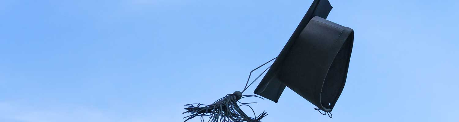 graduation caps up in the air