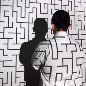 Businessman standing in front of labyrinth