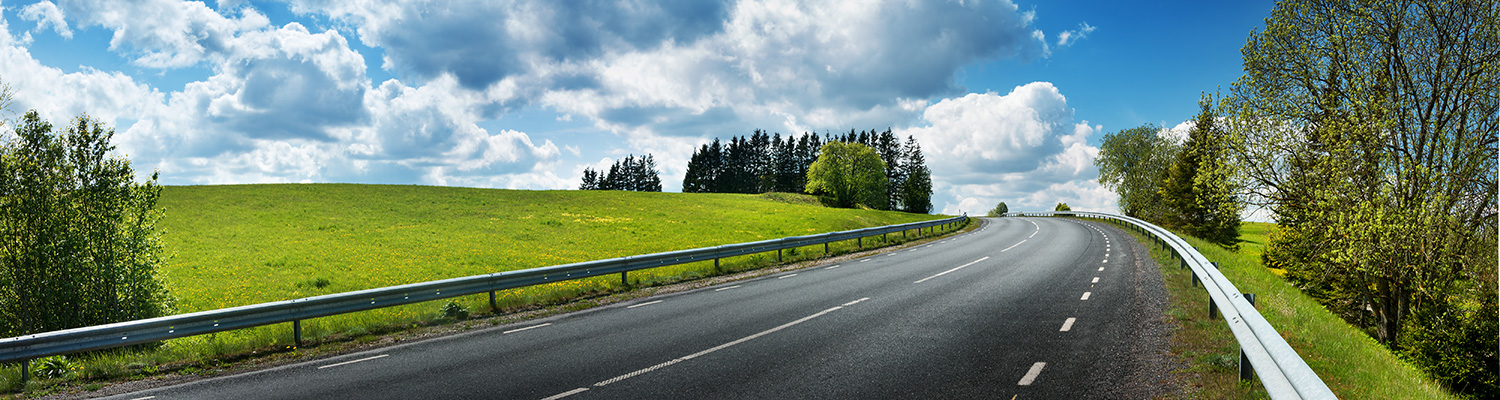 MN Highway Accts Conference, image of rural highway with blue sky and clouds