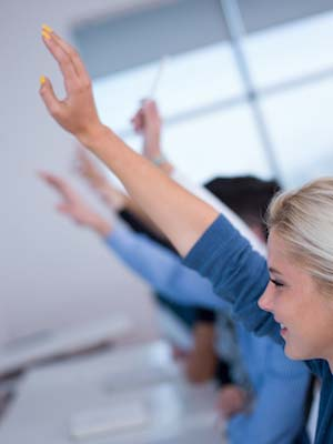 female student raising hand in class